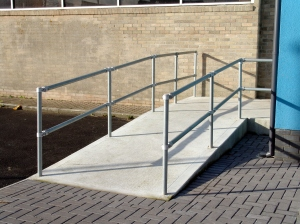 Low cost handrail for ramps